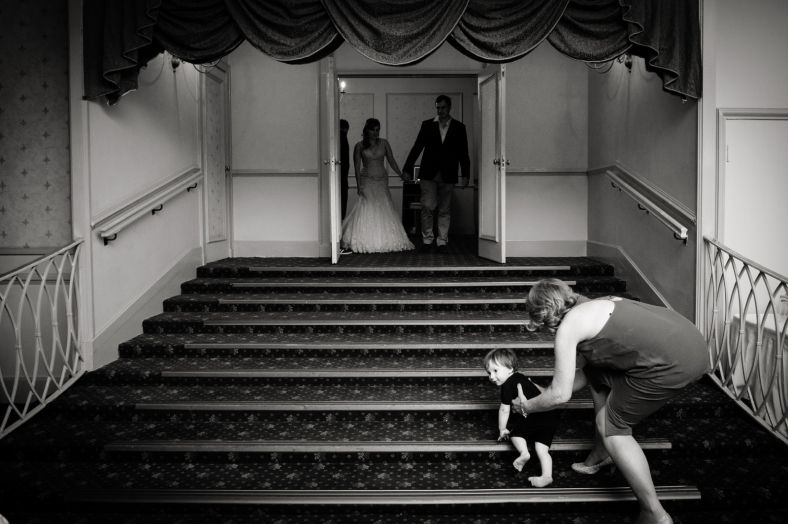 Bride and Groom with child on stairs