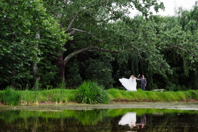 Bride and Groom dancing in willow tree