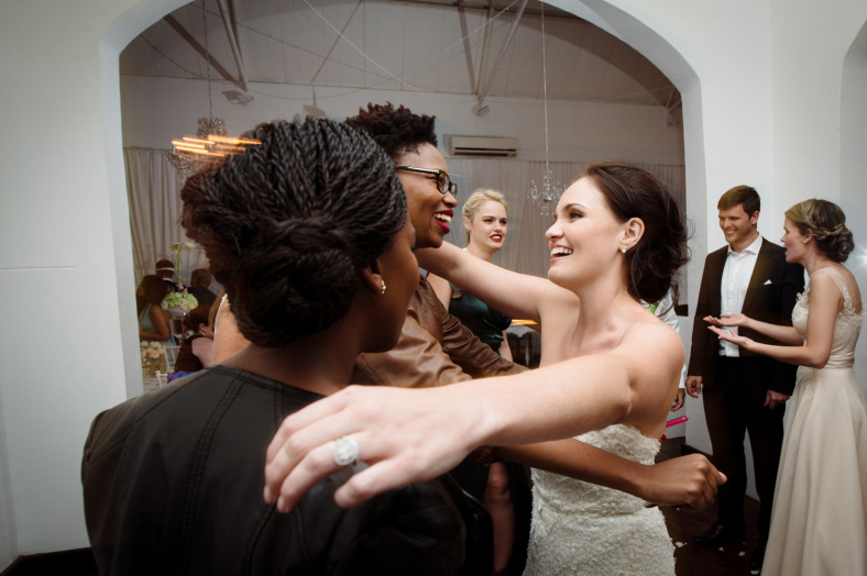 Bride hugs friends