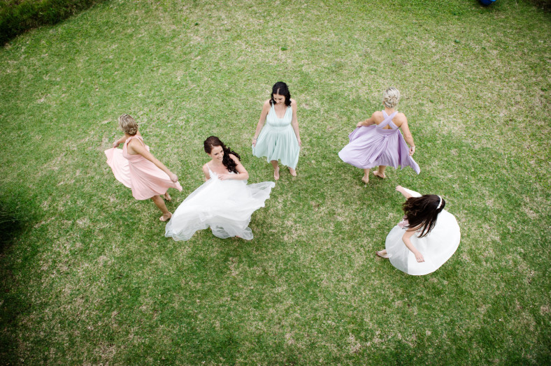 twirling bride and bridesmaids