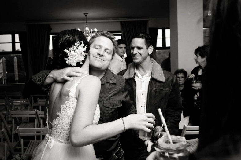 bride hugs friends