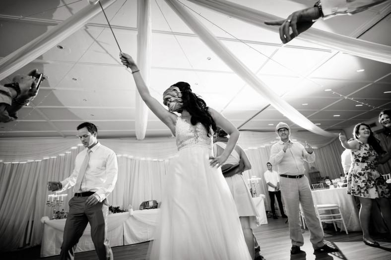 bride dancing in monkey mask