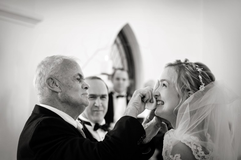dad wiping brides tears