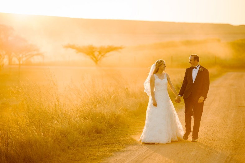 golden sunset with bride and groom