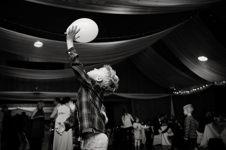 boy playing with a balloon