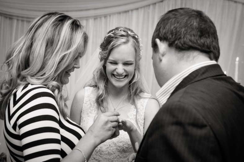 excited bride with wedding ring