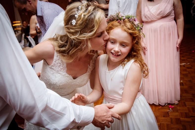 bride kissing daughter