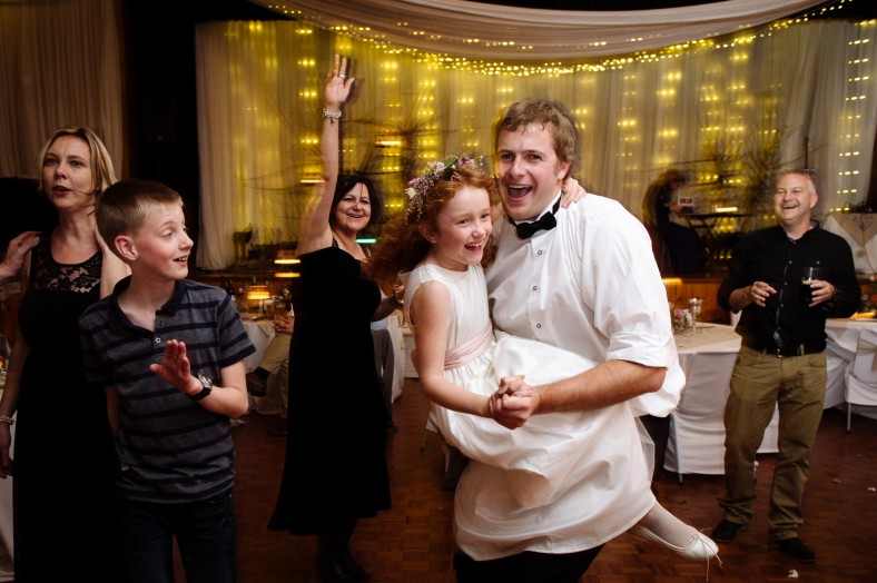 brother and flowergirl dancing