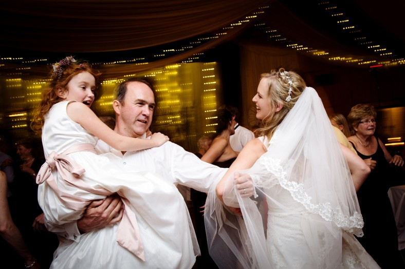 family dancing at wedding