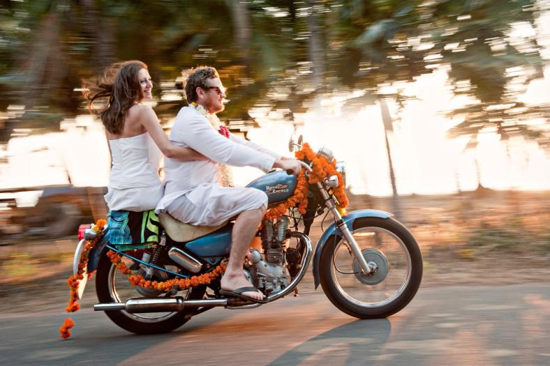 Wedding in India Goa, Wedding couple on bike