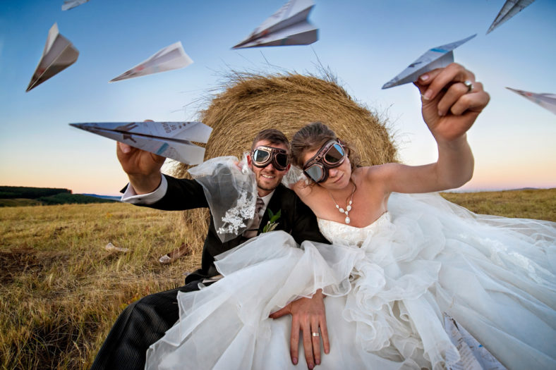 Bride and Groom with goggles and paper aeroplanes