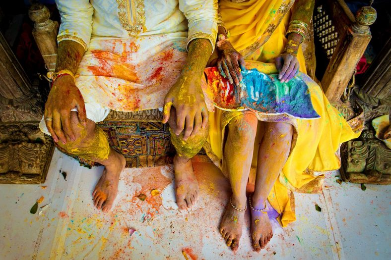 Holi colour fight at traditional hindu wedding function.