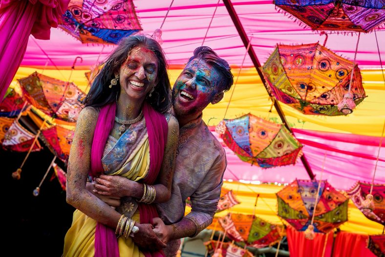 documentary photography of hindu couple covered in holi powder, post holi fight.