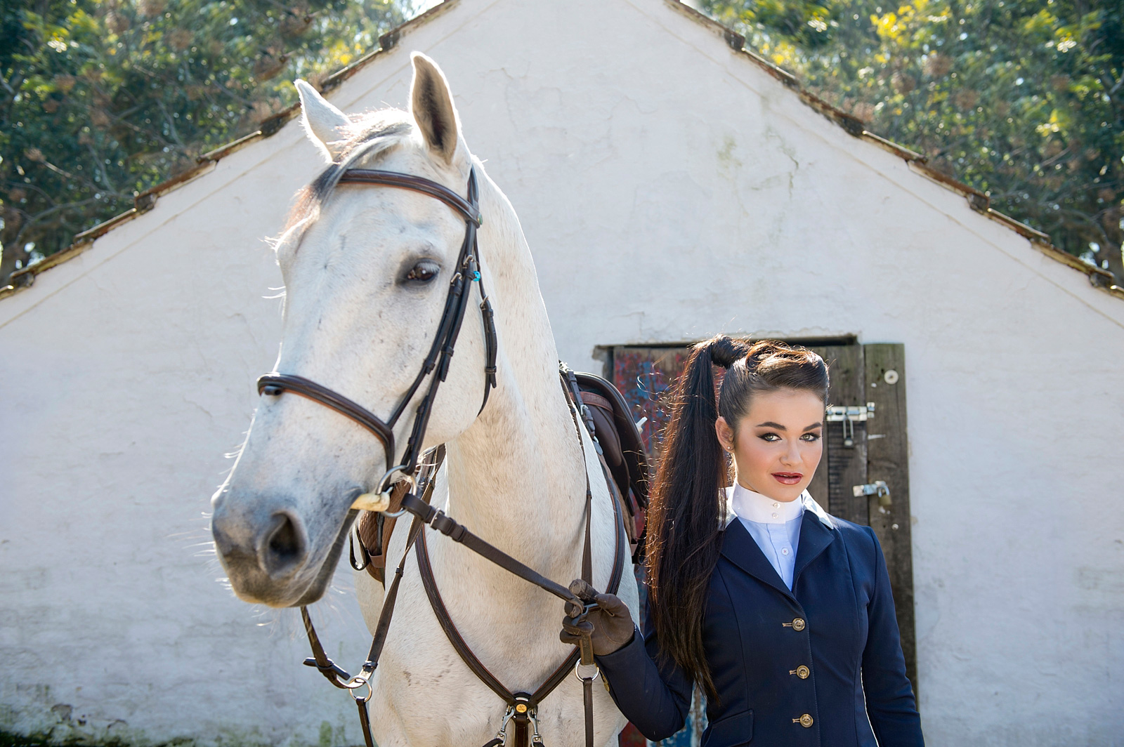 Girl with horse in riding gear