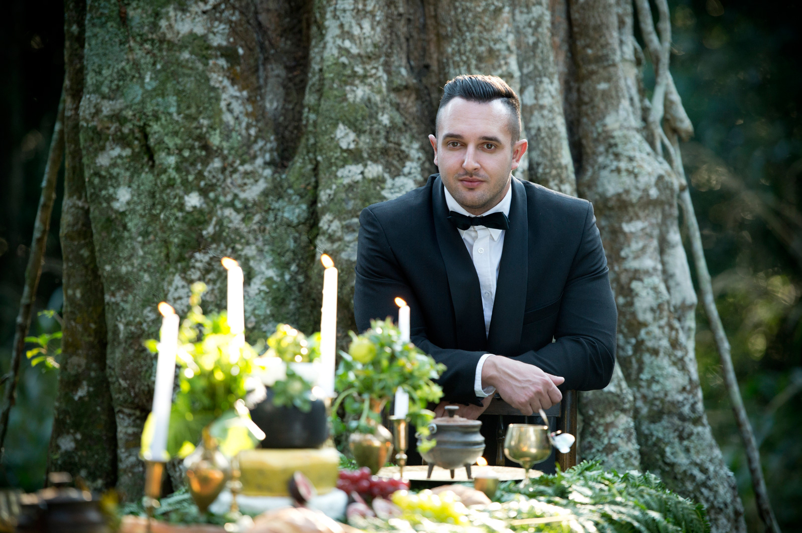 Groom with forrest themed wedding decor