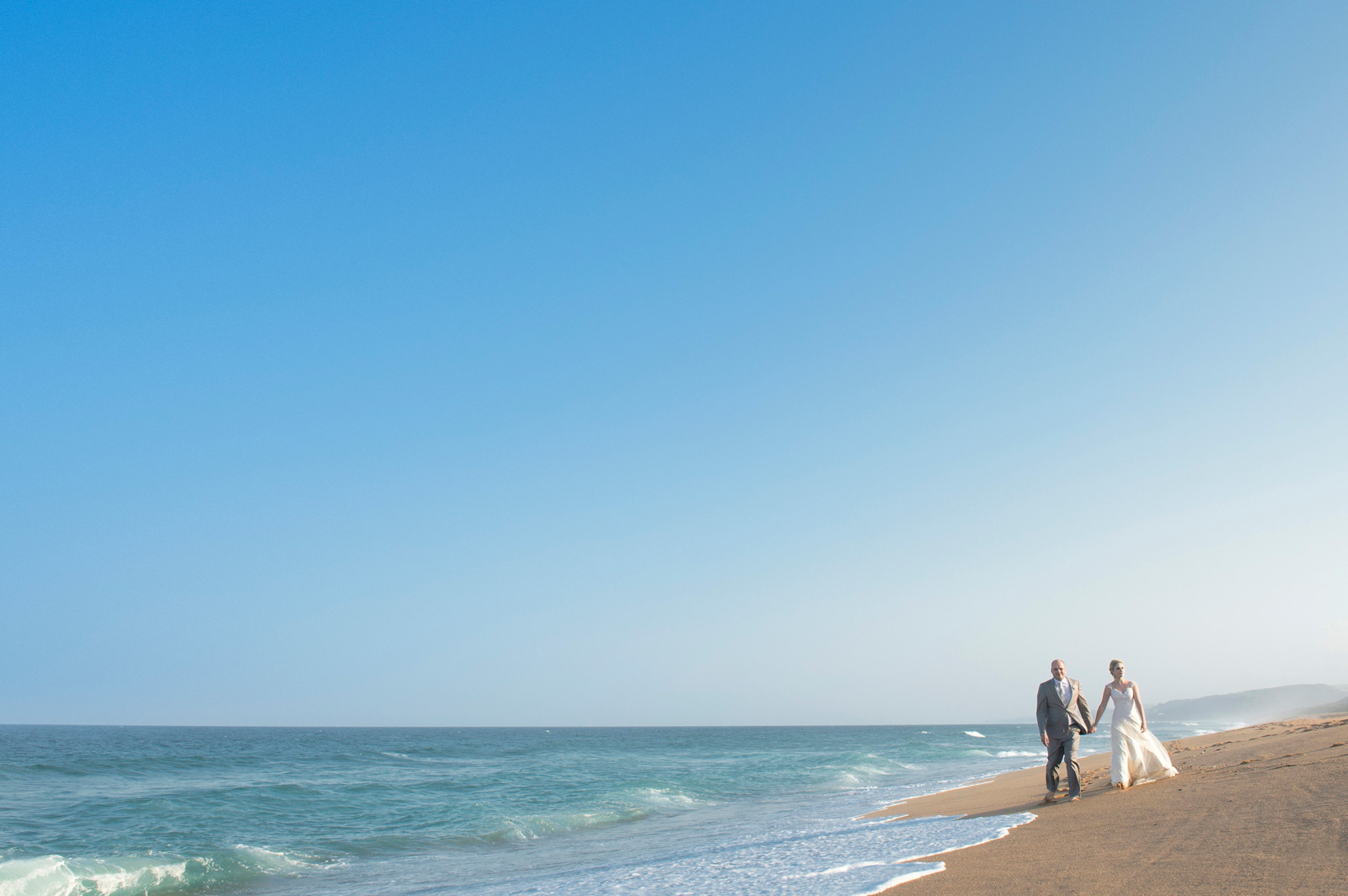Bride and groom on zimbali Beach