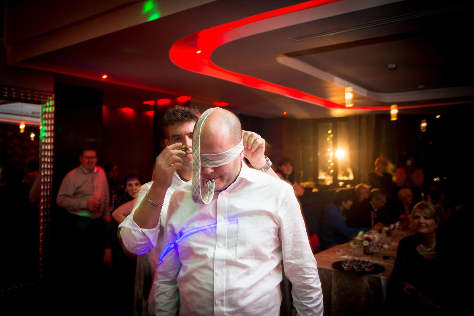 blindfolded groom with garter
