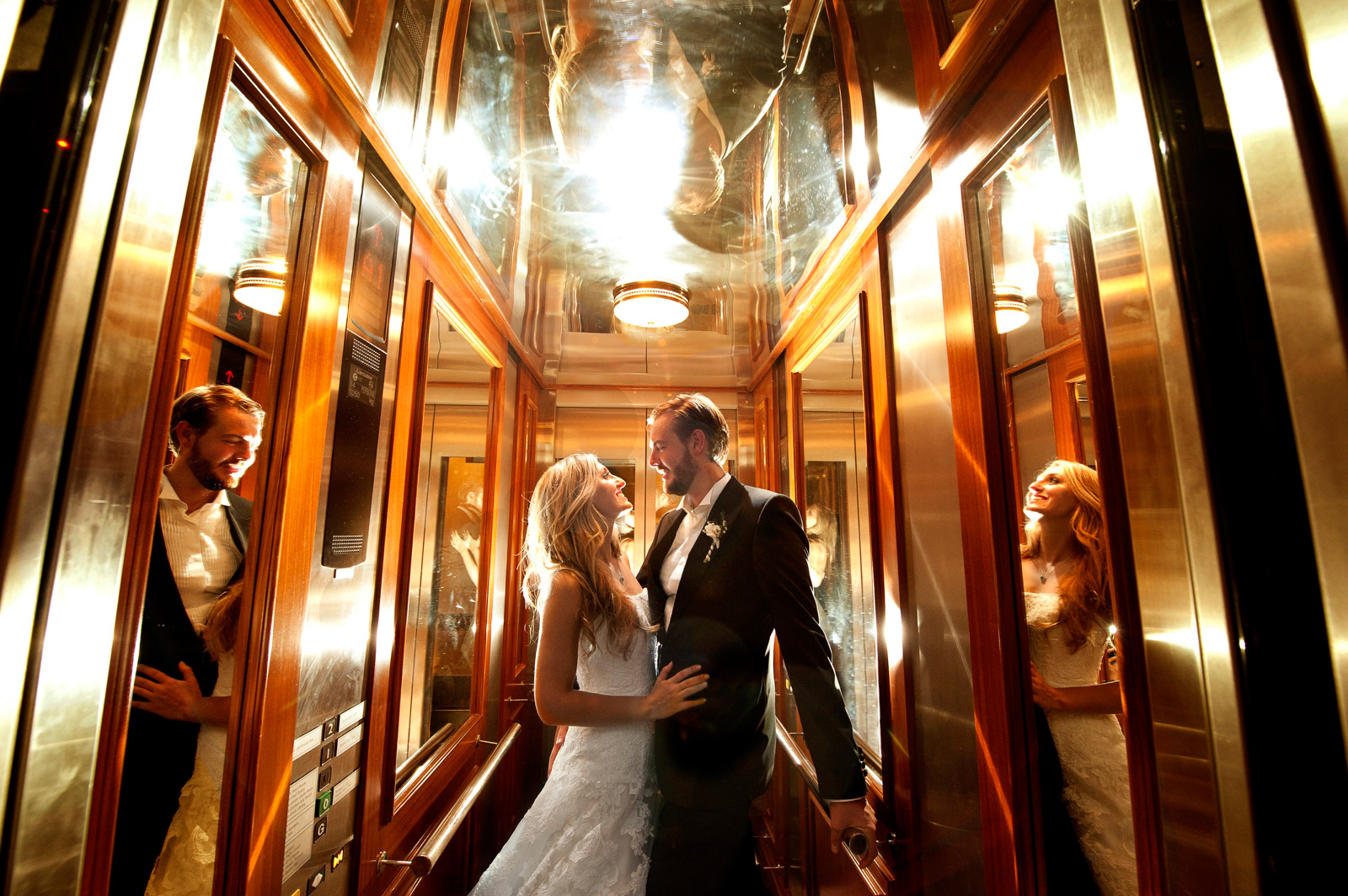 bride and groom in mirrored lift
