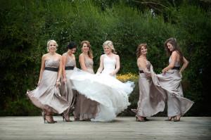 Bride and bridesmaids dancing