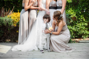bridesmaids with cute page boy