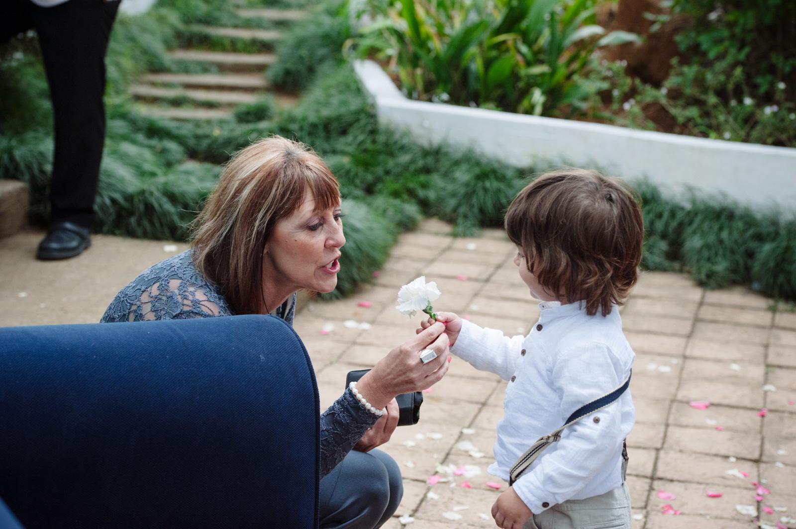 boy giving woman a flower