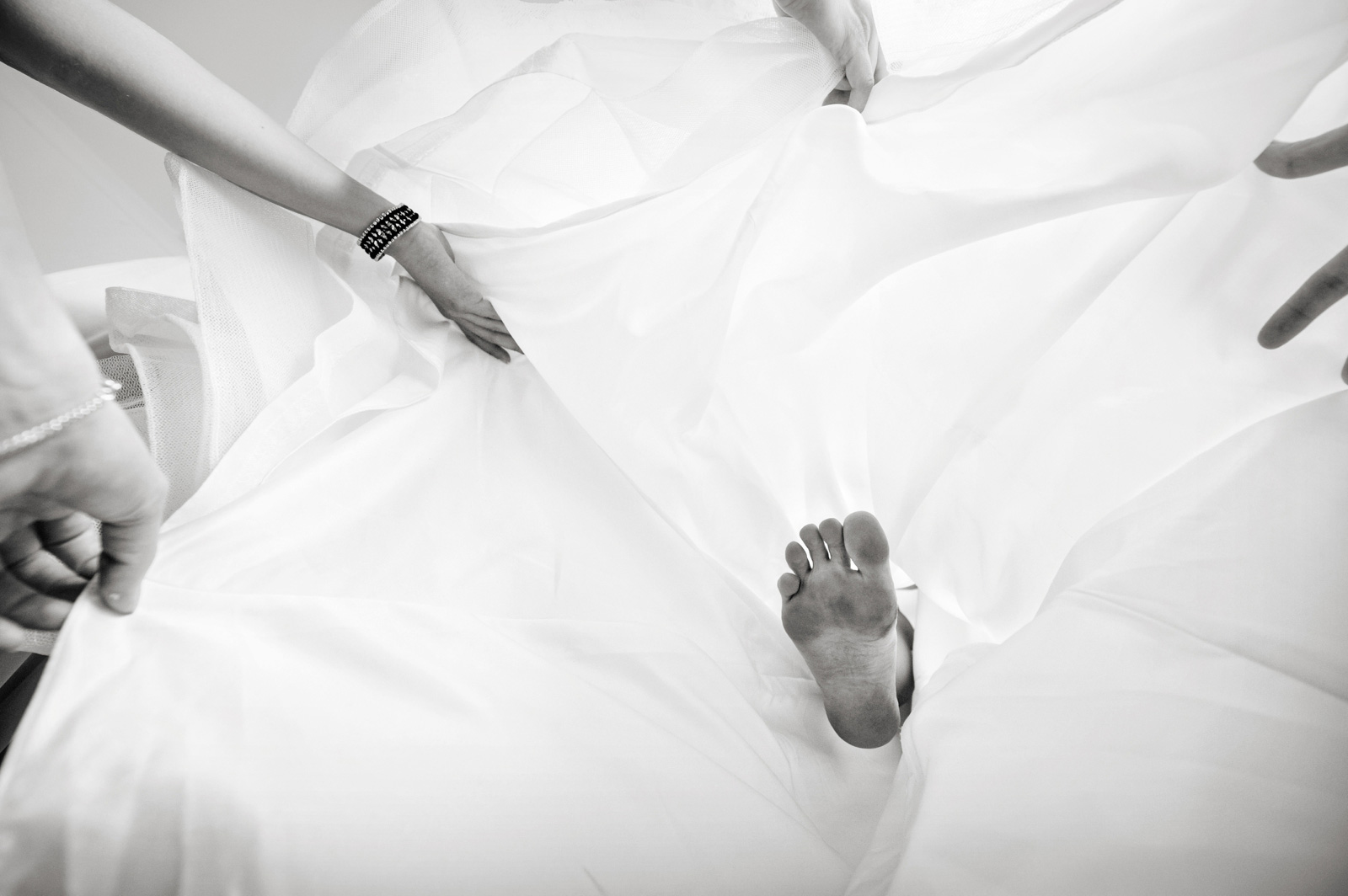 brides foot in dress