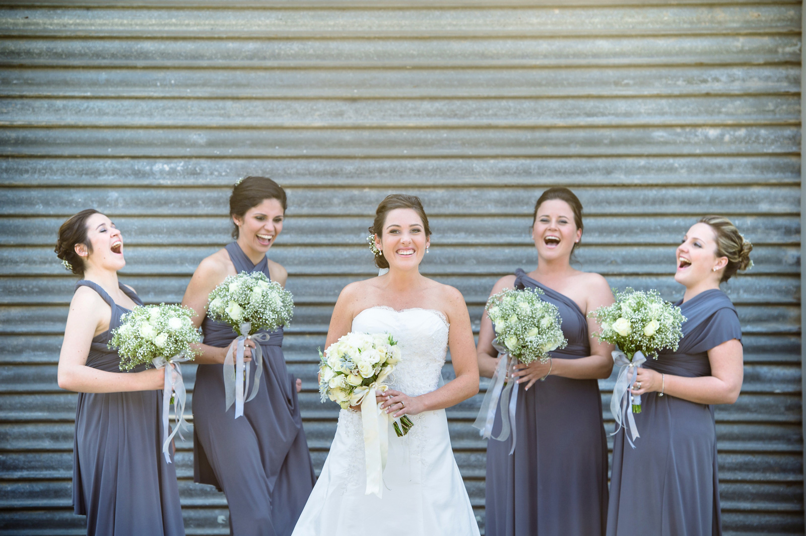 bride with bridesmaids in grey
