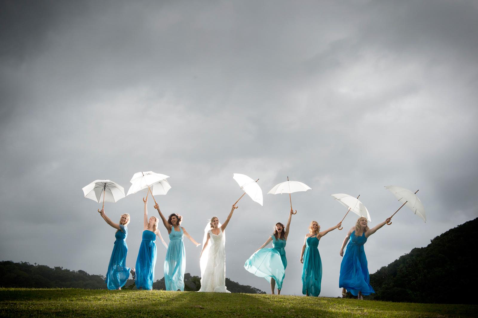 bride and bridesmaids in rain