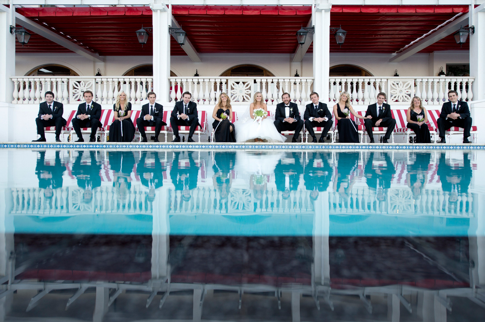 bridal party by a pool