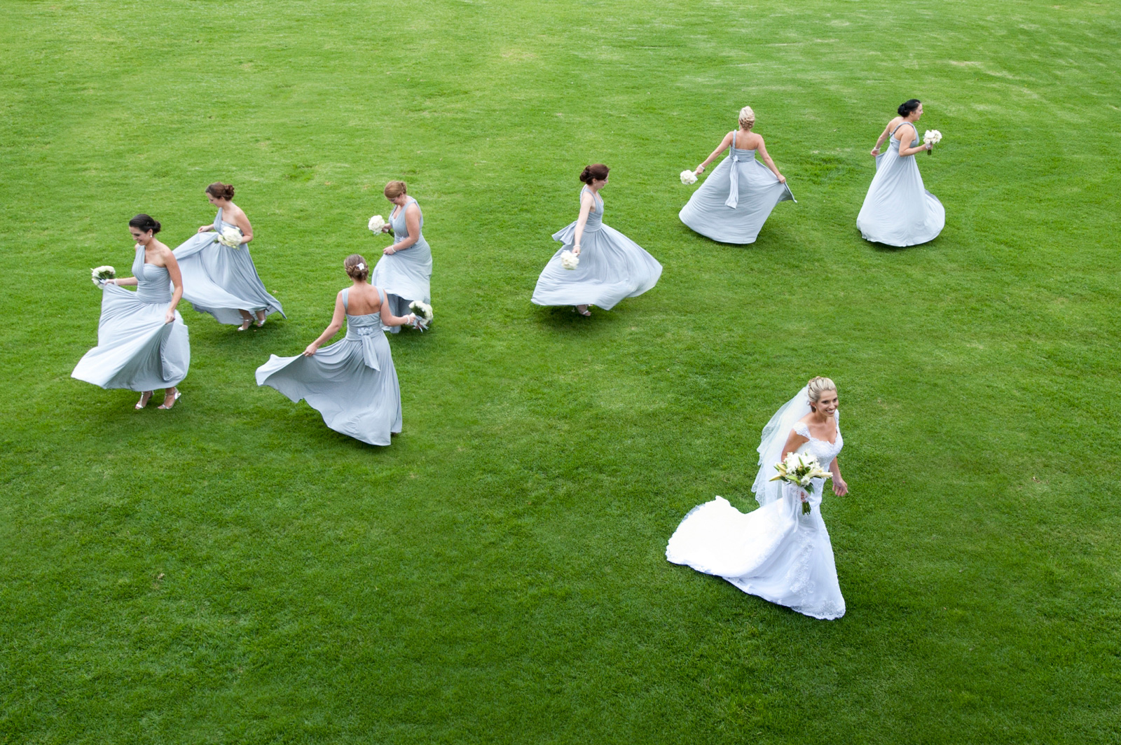 bride and twirling bridesmaids