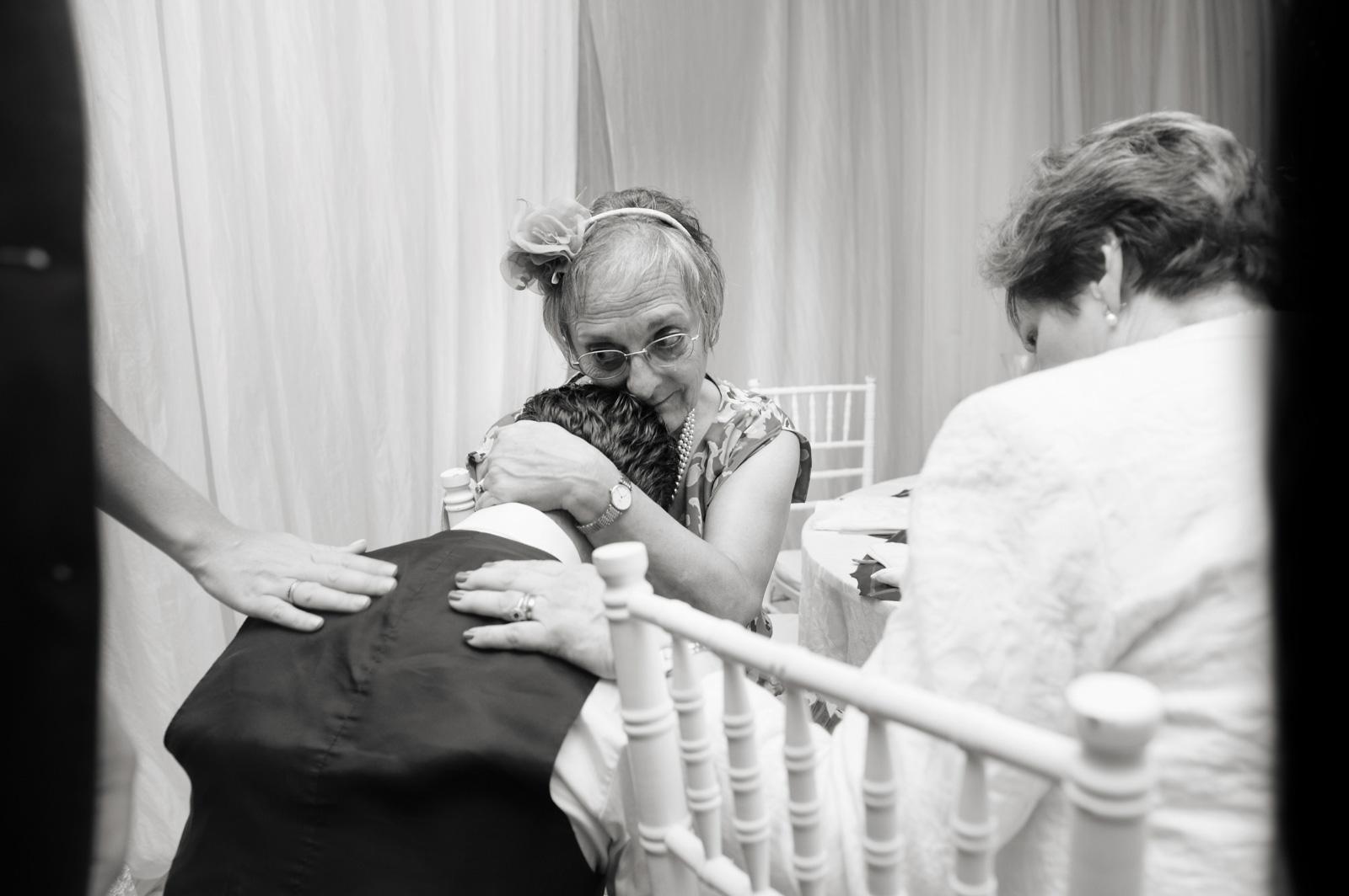 gran hugging groom