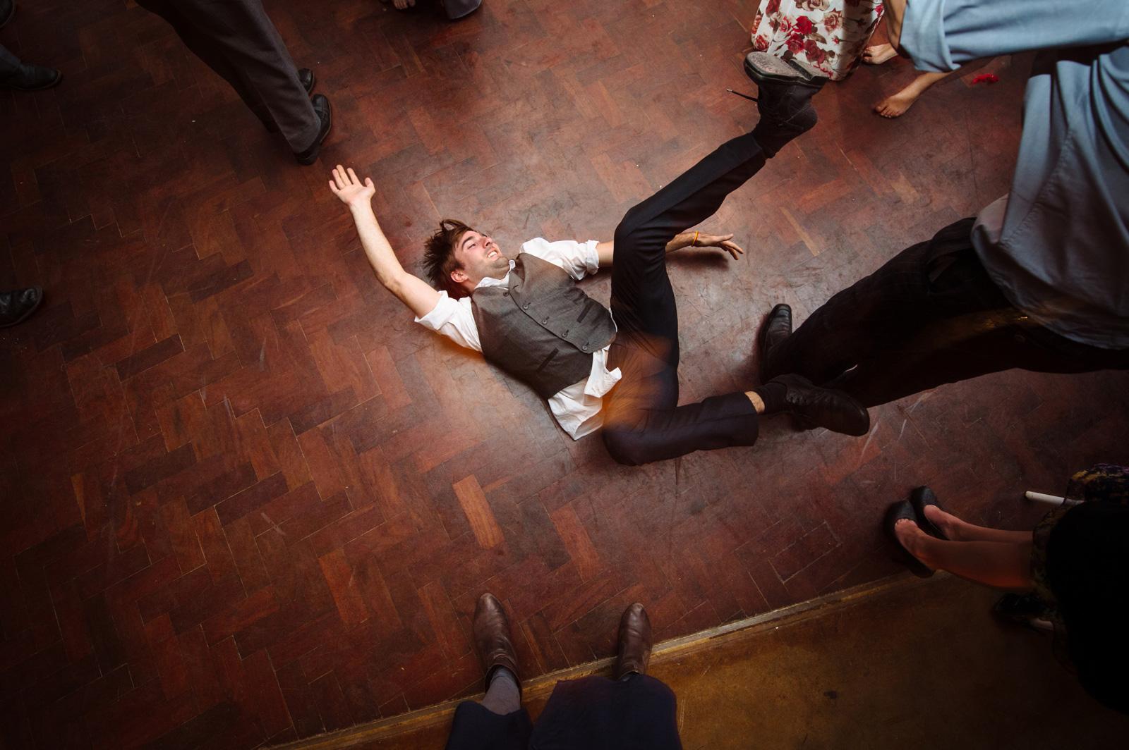 man fallling while dancing