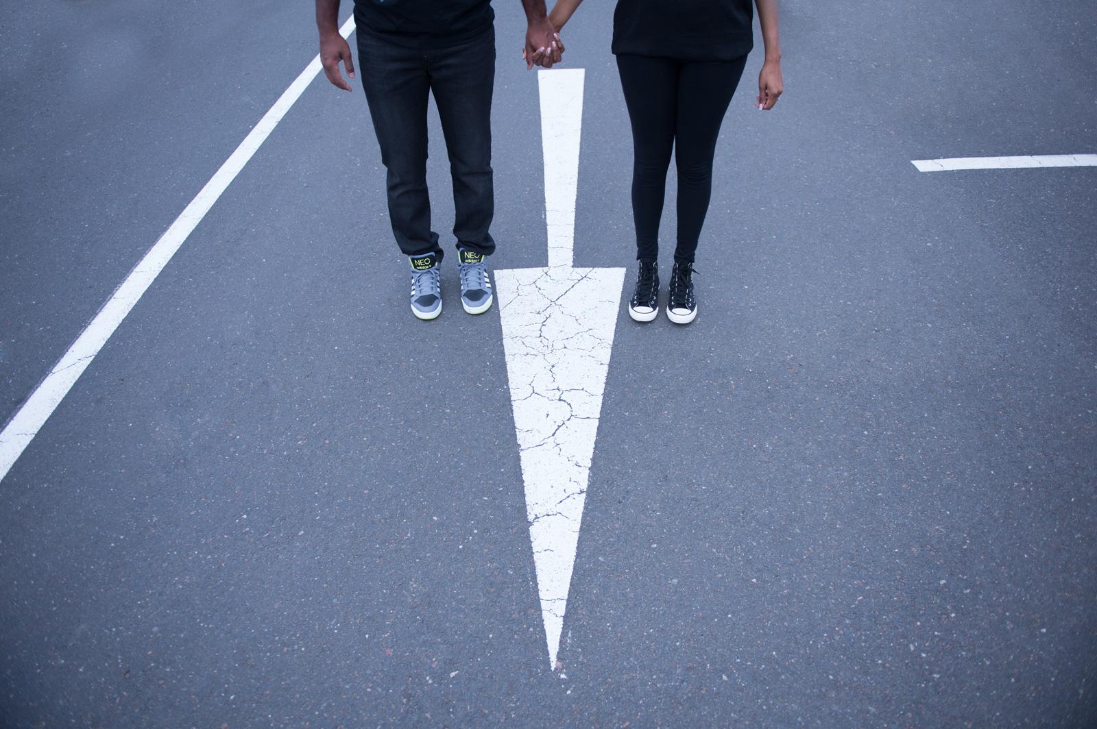 Feet with road arrow
