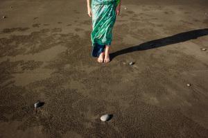 Feet-on-black-beach-sand