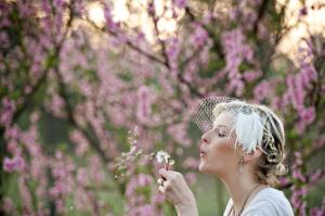 Bride blows dandelion