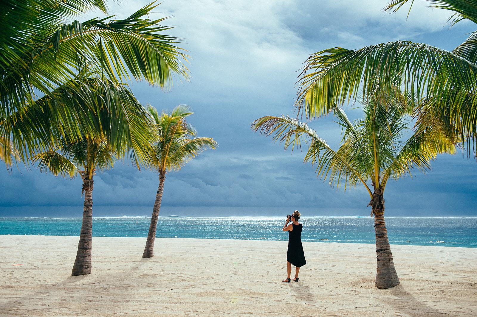 Photographer on location on beach