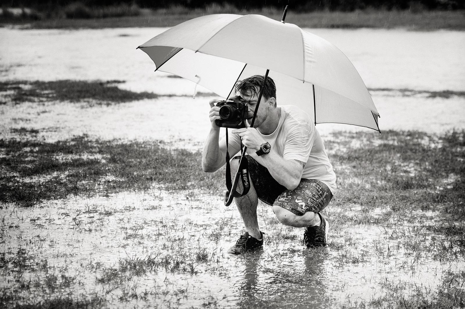 Photographer on location in rain