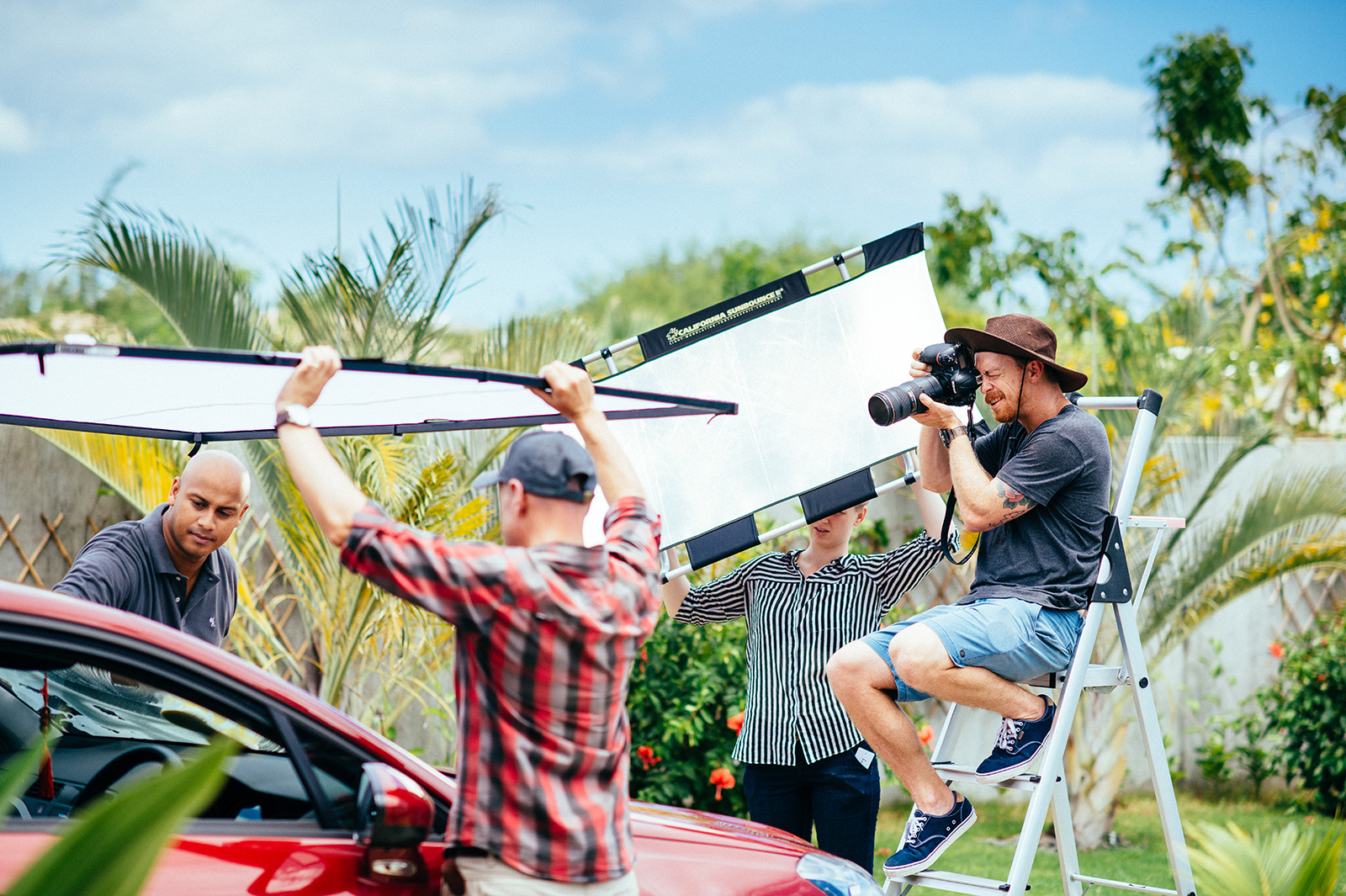 Photographer on location with car