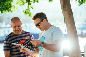 men reading news