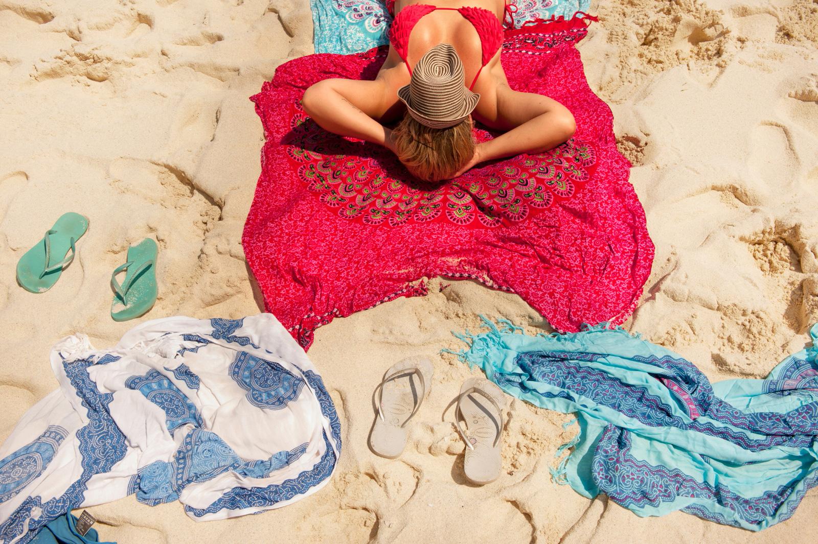 Girl lying on beach