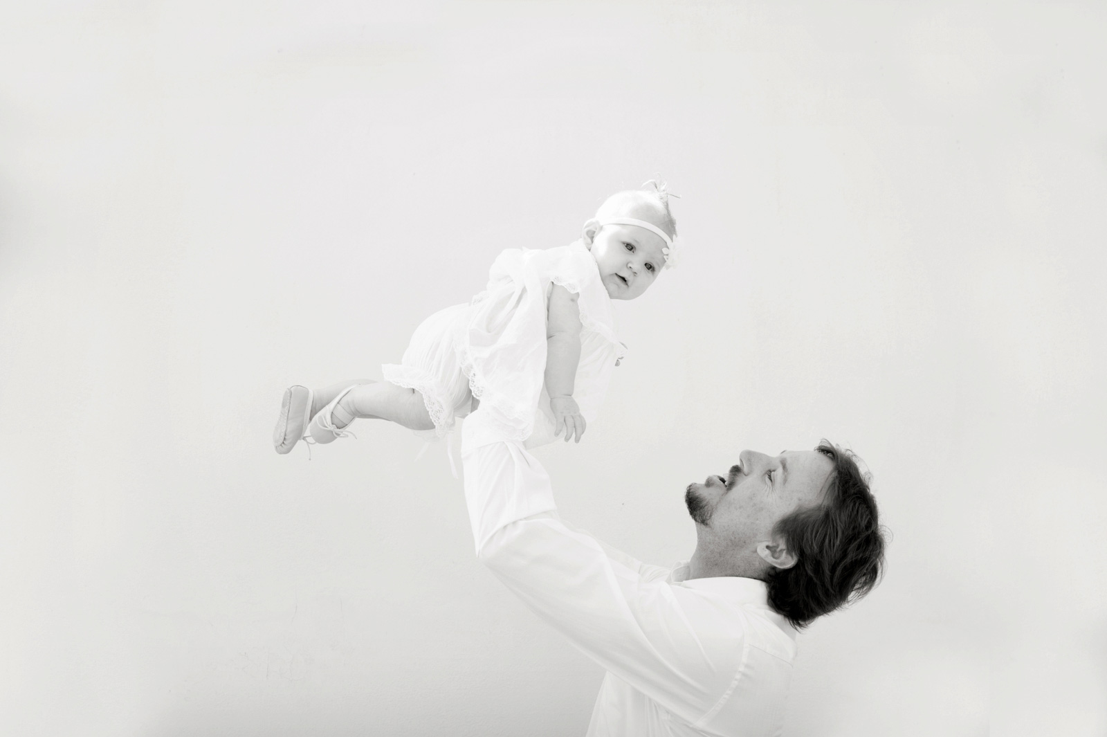 Dad throwing baby