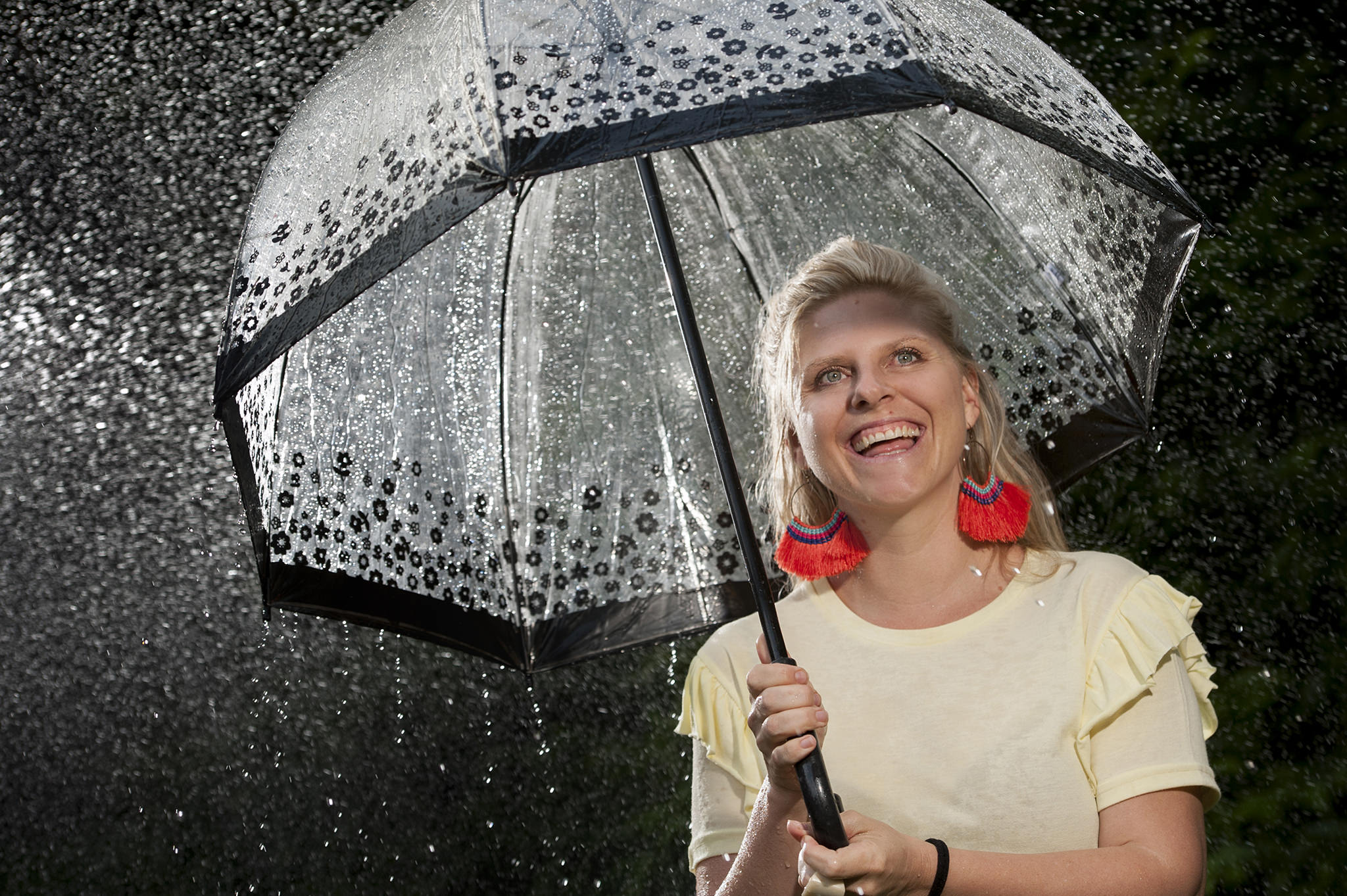 Portrait of a photographer in the rain with an umbrella
